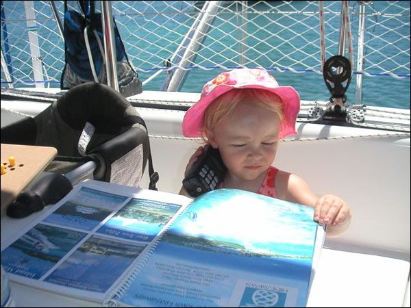 First Mate Bailey Monitoring Channel 16 and Cruising Guide, picking tomorrows destination