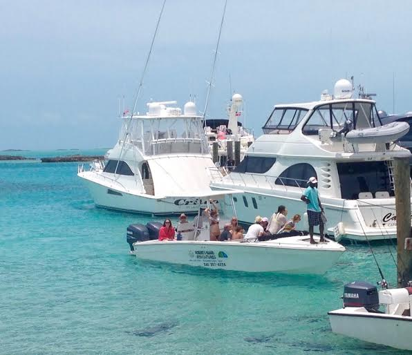 This is one of the smaller tour boats, making its rounds, pulling into Staniel Cay. We saw some big go-fast tourist boats with over 50 people in them.